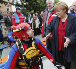 German Chancellor Merkel talks to water rescuer Hochleitner as s