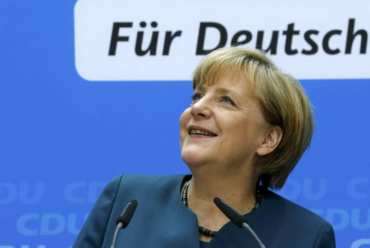 German Chancellor Merkel smiles during news conference after CDU party board meeting in Berlin